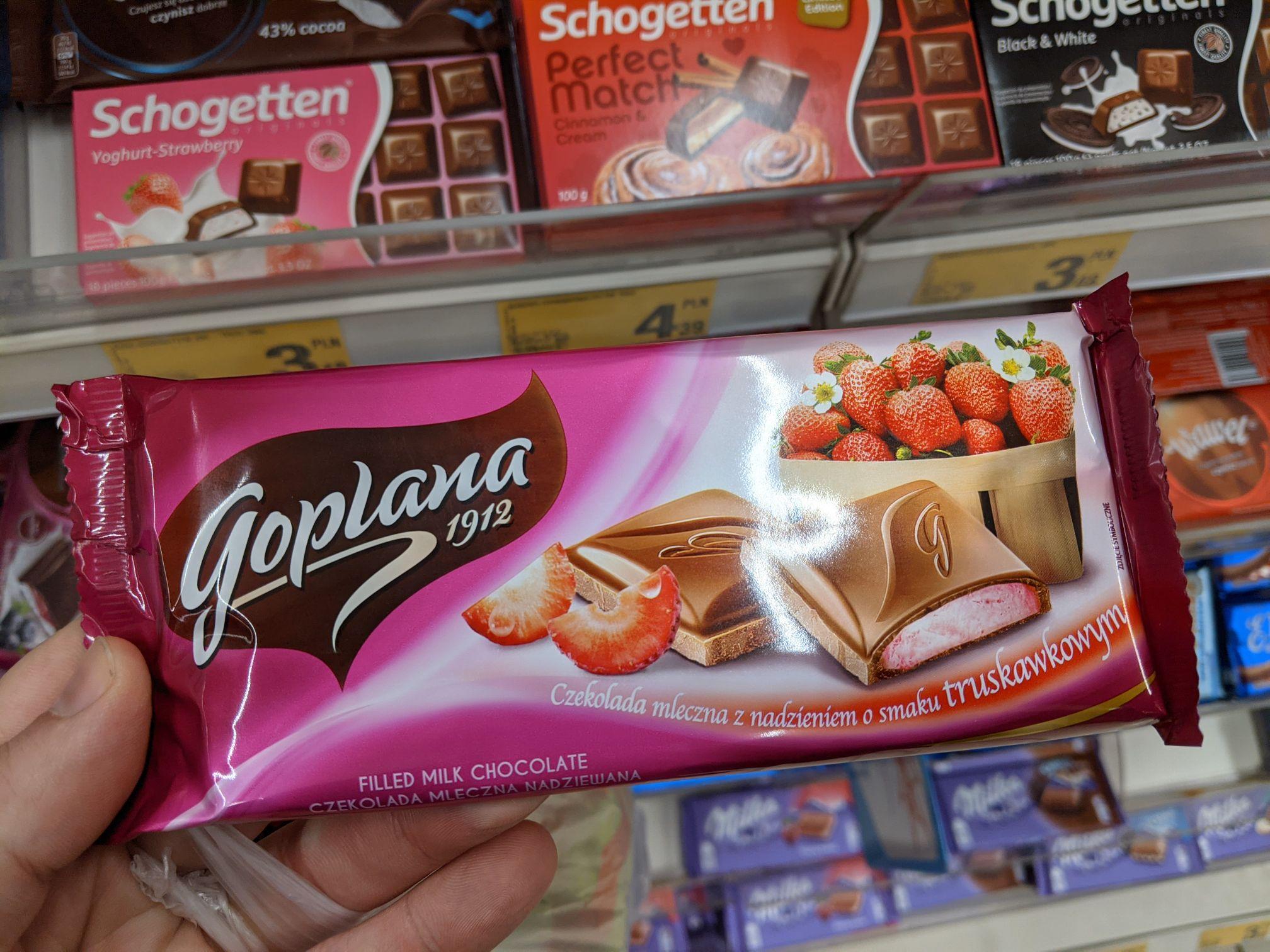 Czekolada mleczna z nadzieniem o smaku truskawkowym Goplana 88g. Auchan