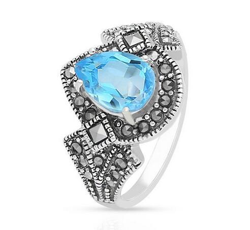 Pierścionek srebrny z topazem swiss blue i markasytami