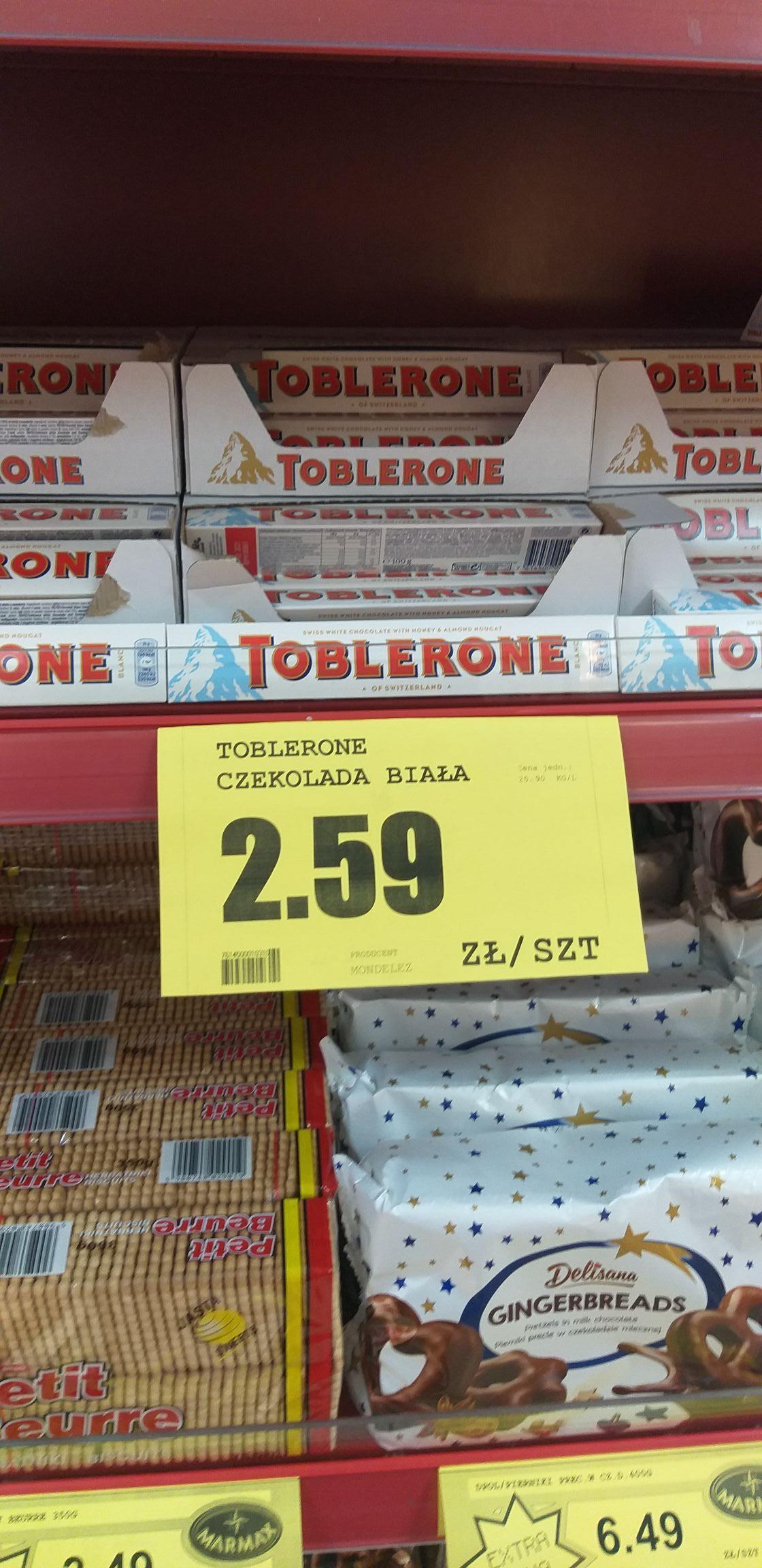 Toblerone Szwajcarska czekolada biała z nugatem miodowo-migdałowym 100g, Marmax Rzeszów